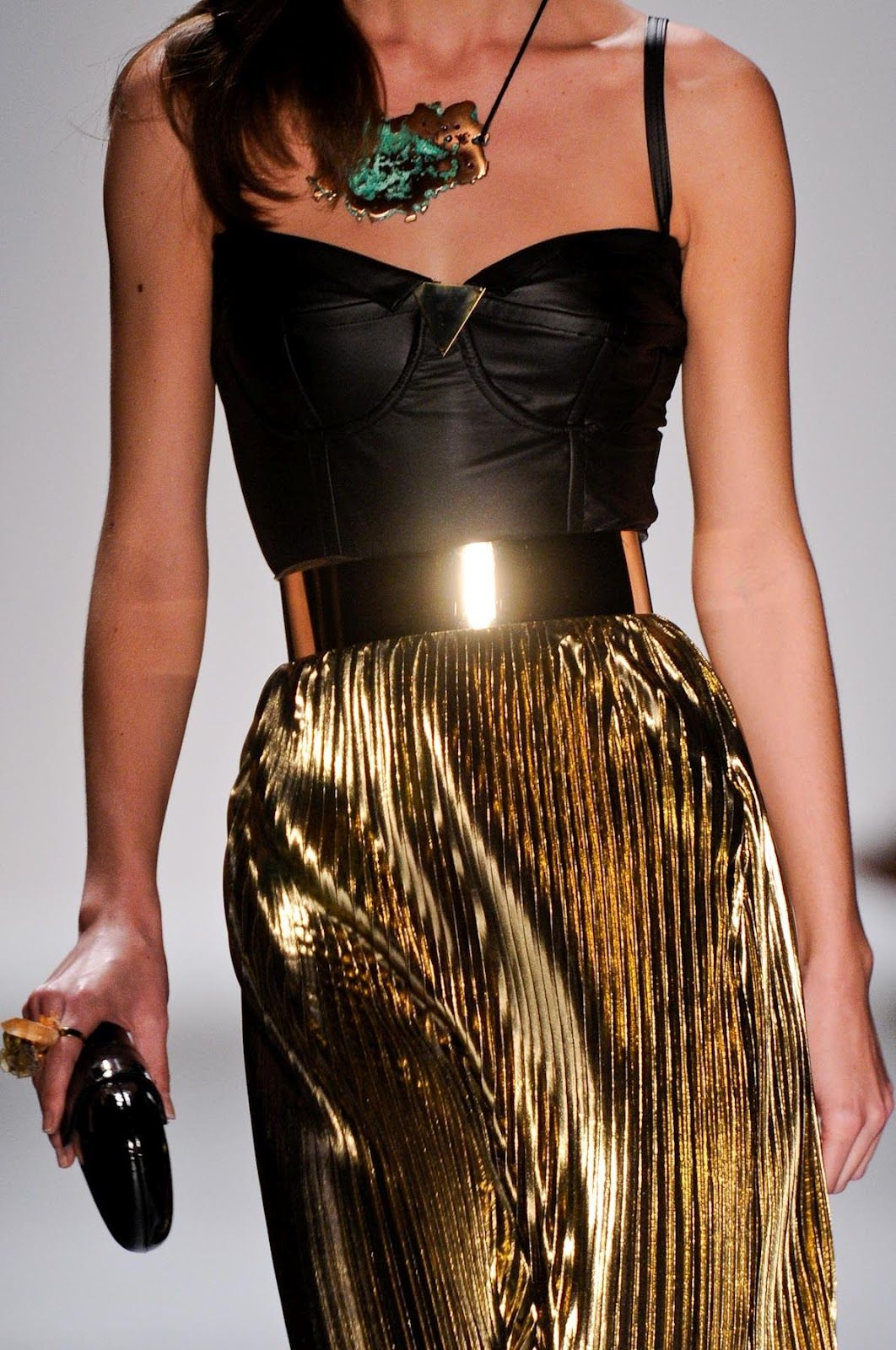 fitted leather top with belted metallic gold pleated maxi skirt