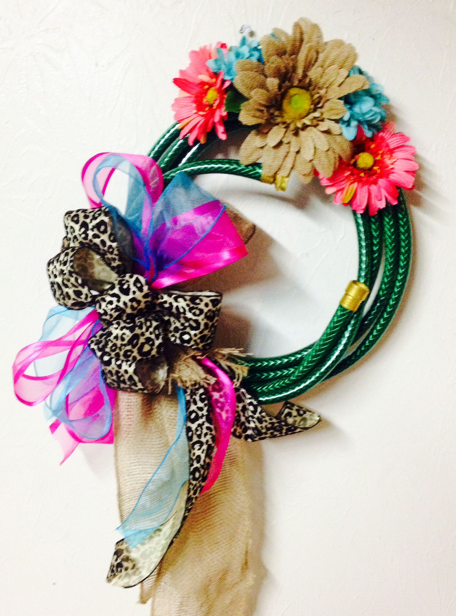 Water hose wreath for spring.