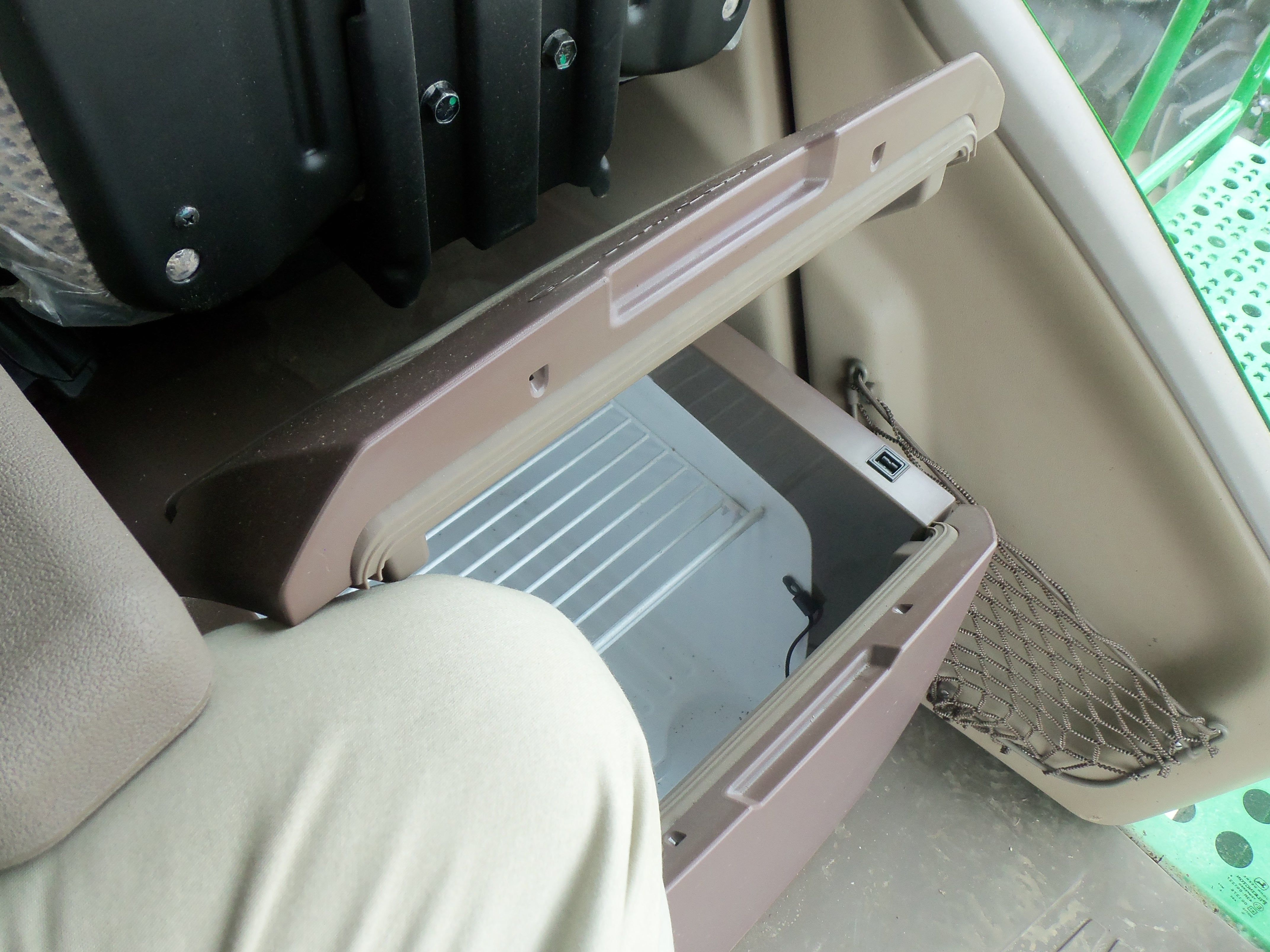 INside thie JOhn Deere S680 will find this refrigerator disguised as a additional seat