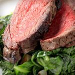 Photo of Peppery Breakfast Steaks Over Wilted Spinach-Peppery Breakfa…