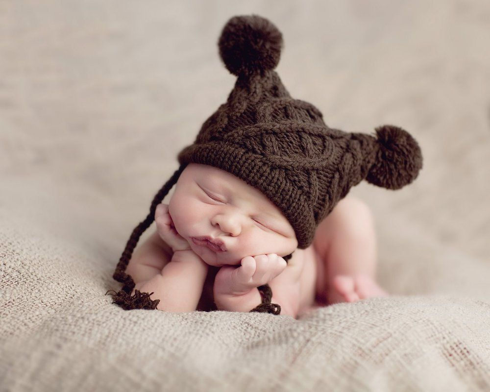 newborn cable knit hat. i don't want to buy this for $28. i want to make it. anyone got a pattern???