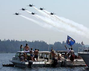 The Blue Angels make a pass over the log boom at the 2009