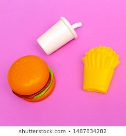 Plastic fast food on colored background Junk food flat lay food