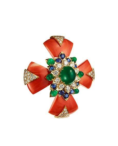 Coral, green onyx, diamond, sapphire, and gold'Maltese Cross Coral Brooch' (circa 1964).