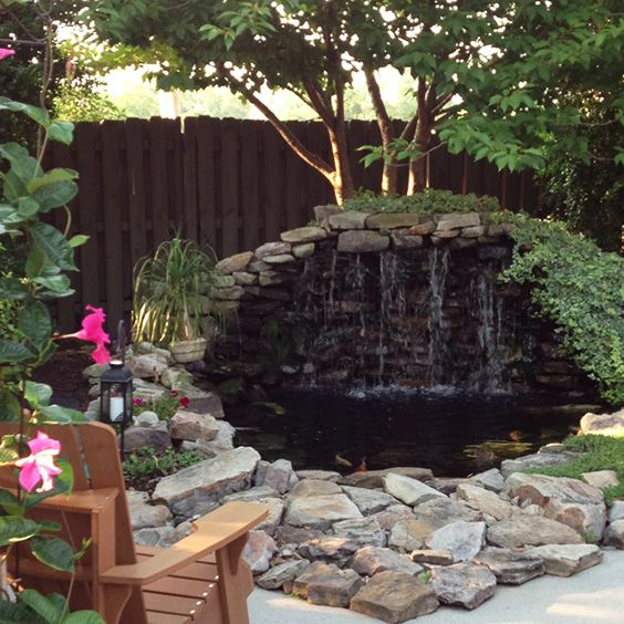 Invite mystery into your yardscape with a bit of height and depth using rocks and water. This intriguing design was built into piled soil leftover from the pond and reinforced using concrete and stacked landscape rocks.