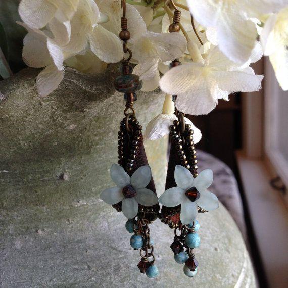 Light blue lucite flower dangle earrings by kimberlyddesigns