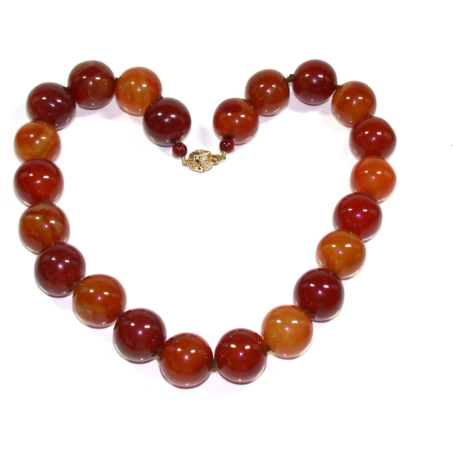 Fantastic Carnelian Bead Necklace with a 14kt yellow gold clasp perfect for everyday over a turtleneck, with a tee shirt or as an accessory with that little summer dress. You will wear this every season and with the warm earth tones, this goes with everything you already own! Twenty two (22) beads measuring 1/2 inch each and kept closed by a very secure clasp.