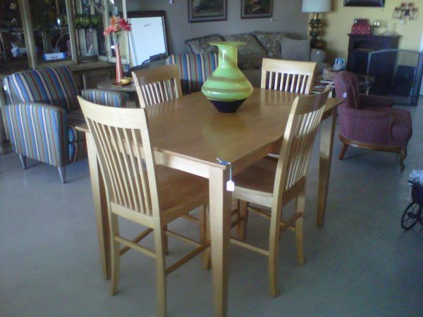 Gorgeous blonde counter height dining room table with an internal