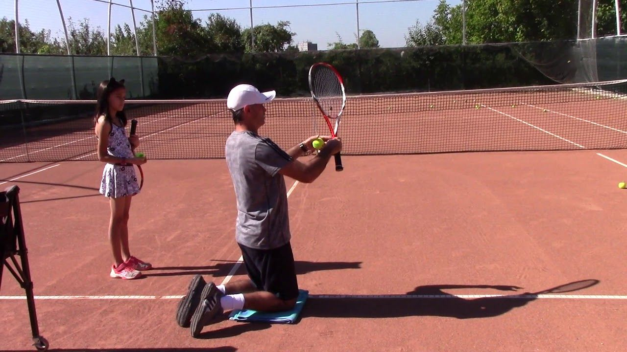 Tennis Lesson Learning The Kick Serve Spin On The Knees Tennis Lessons Tennis Workout Play Tennis