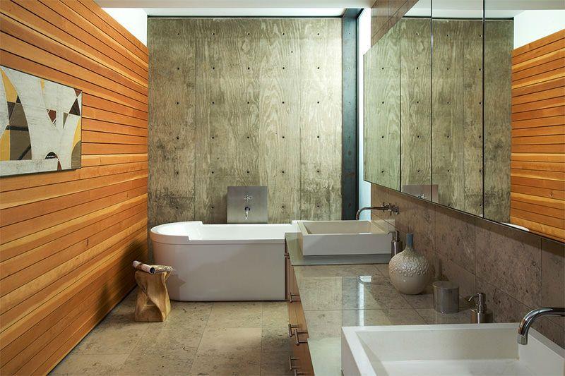 15 ejemplos perfectos de ambientes con paredes de concreto Baños y - paredes de cemento