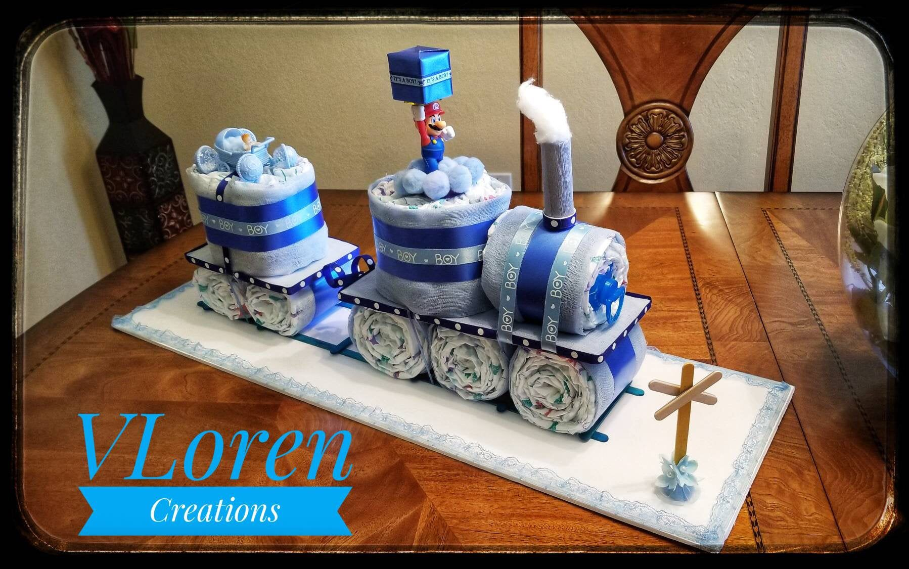 Baby gift blue train diaper cake for boys baby shower in