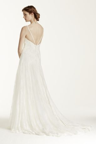 This stunning lace trumpet gown is sure to wow on your special day!  Sleeveless all over Chantilly