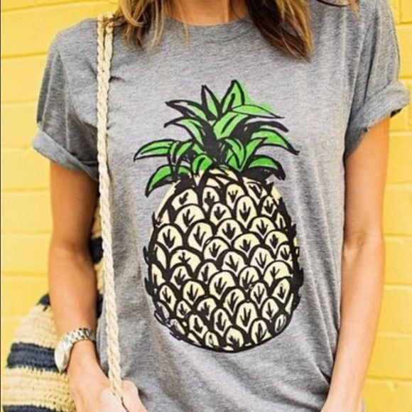 Pineapple t-shirt graphic tee Super chic pineapple tshirt. Pineapples are so trendy this summer! You all need this shirt! So cute! Not Zara. Fits loose like photo. Third photo just shows famous fashion blogger who is always ahead of the trend sporting pineapples.. Sincerely Jules. I personally like my shirt better lol.. Next day ship! Zara Tops Tees - Short Sleeve