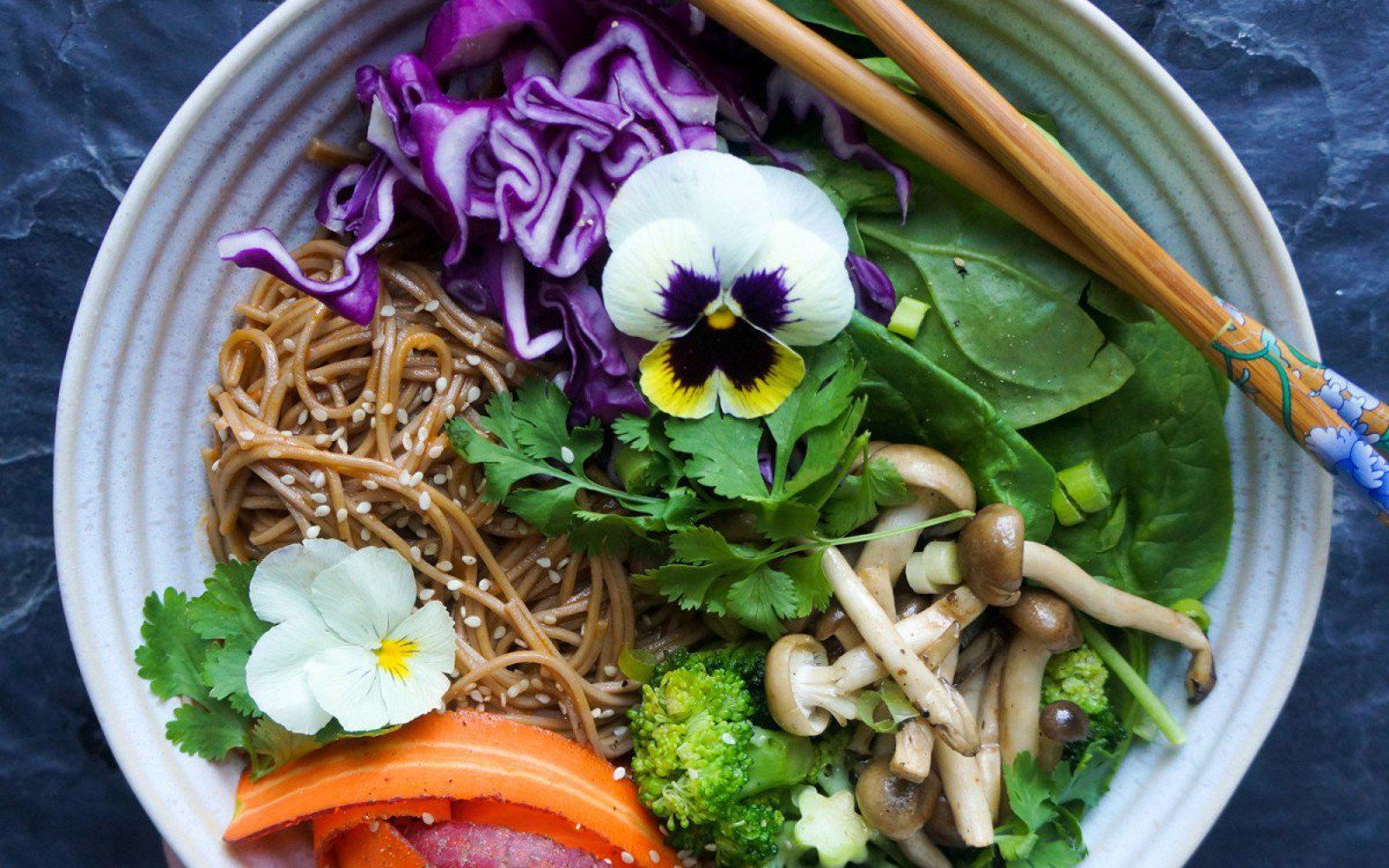 In this recipe, Thai red curry is made creamy with coconut milk and used as a base to soba noodles with plenty of mushrooms and flavorful vegetables.
