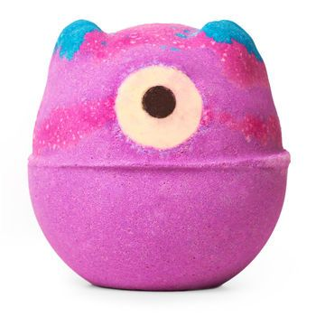 Monsters' Ball Bath Bomb: Throw yourself a ball by reveling in possibly the most beautiful bath water ever. This cyclops' outer layer creates layers of pink froth on top of deep blue-purple waters as its fruity lime and neroli perfume fills the air.