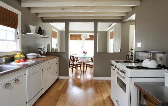 white, grey, white cabinets, retro stove, butcher block countertops, open shelving