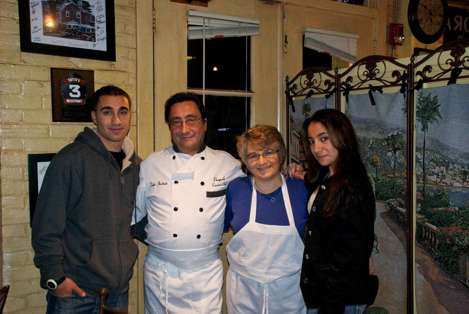Tutti's Ristorante is the restaurant that my parents own in Westport, CT.  They have had this restaurant for about 10 years and my dad is the chef.  In this picture there is my brother, dad, mom, oh! And theres me! :) Come in try the good Italian food!  Or check us out at www.tuttisonline.com