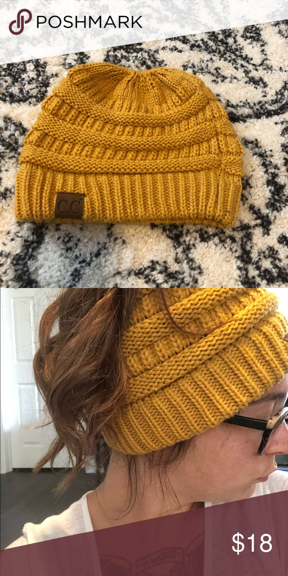Mustard yellow ponytail beanie hat Super cute mustard yellow ponytail hat.  Just purchased this last winter and only worn a few times C.C Accessories  Hats 9a1dddc9df8b