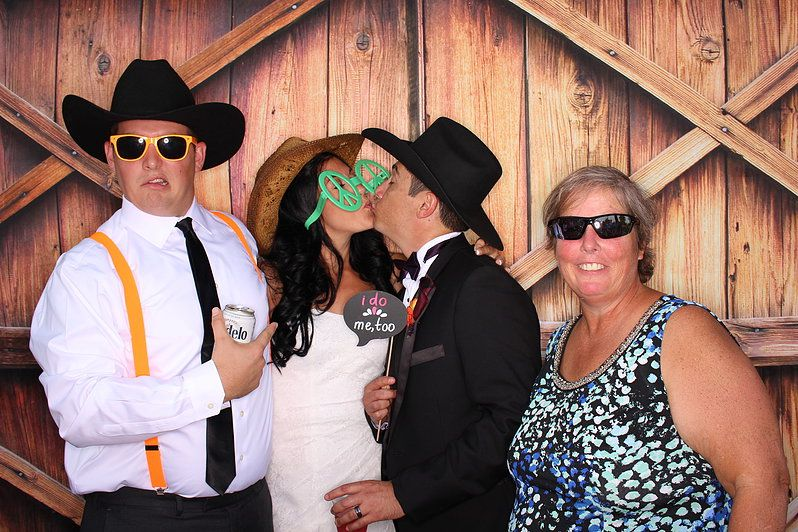 Open Air photo booth with barn door backdrop. Photo