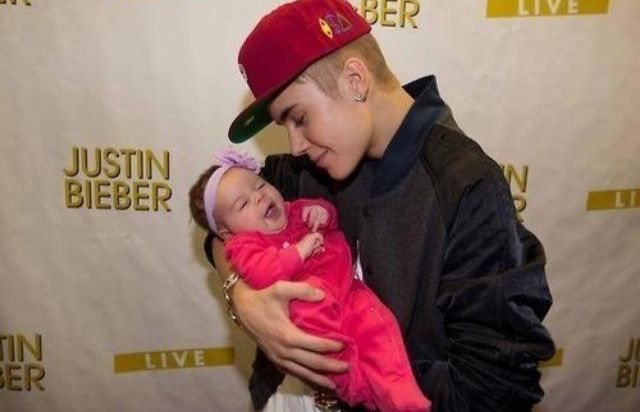 Justin bieber with a baby during a meet and greet for the believe justin bieber with a baby during a meet and greet for the believe tour 2012 m4hsunfo