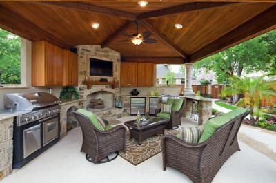 Example Of An Outdoor Living Room With Grille And Fireplace