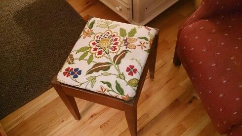 Thrift store stool that I recovered with brighter fabric. Total cost 6 bucks.