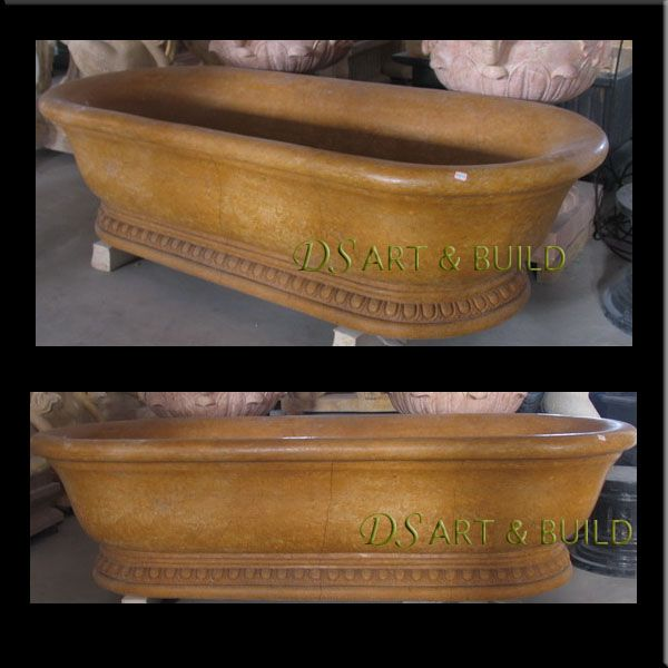 This site has some really beautiful hand carved nature stone bathtubs in limestone, travertine, Onyx, and marble.  The limestone heats up with your water and keeps it hot.  I would love to have one of these!