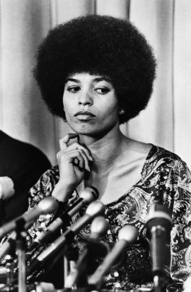 23 Sep 1969, Los Angeles, California, USA --- Admitted Communist and UCLA philosophy instructor Angela Davis said at a press conference that she was fired for racist, not political reasons. --- Image by © Bettmann/CORBIS