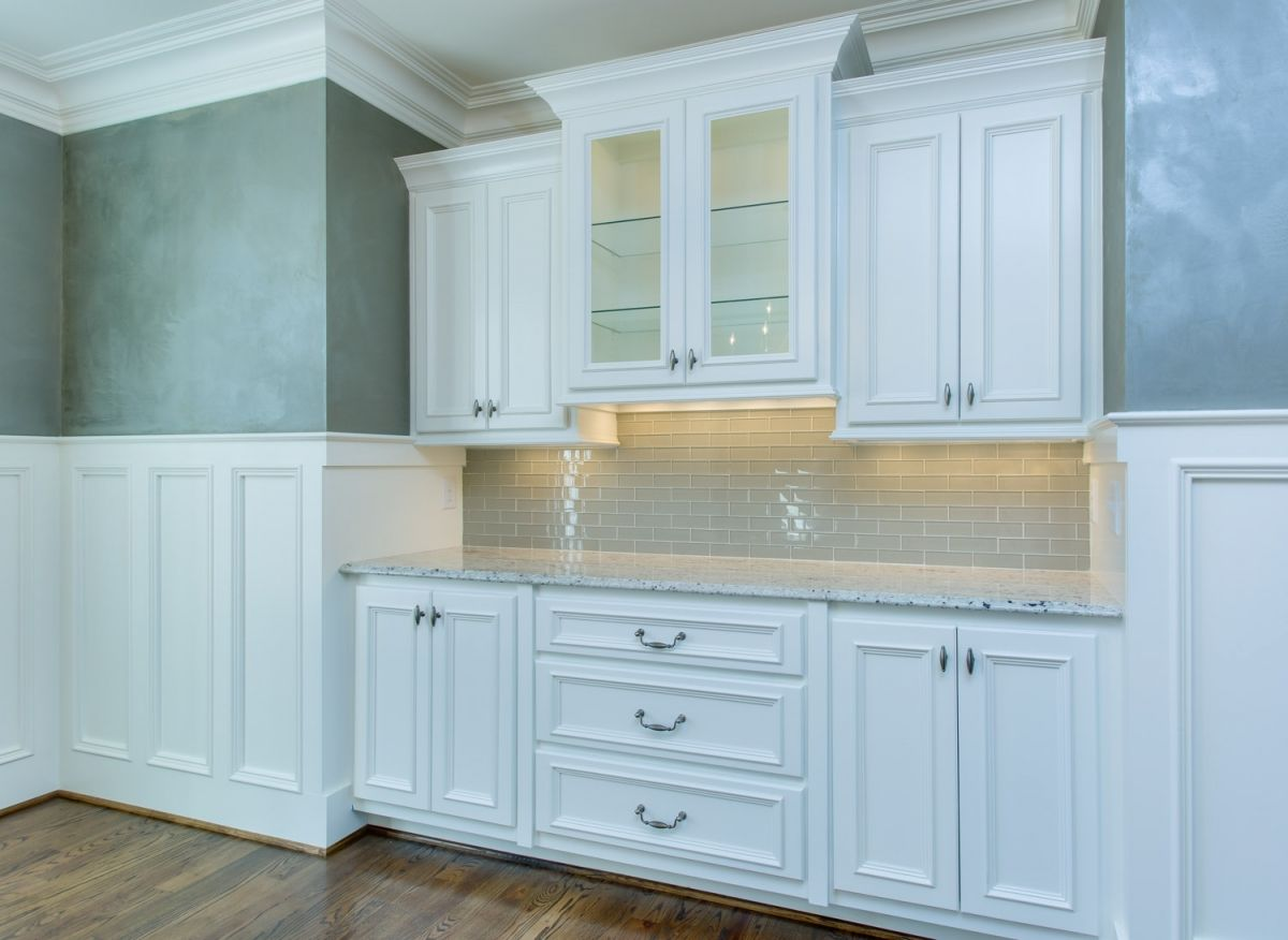 Beautiful white built-in china cabinet in the formal dining room of ...