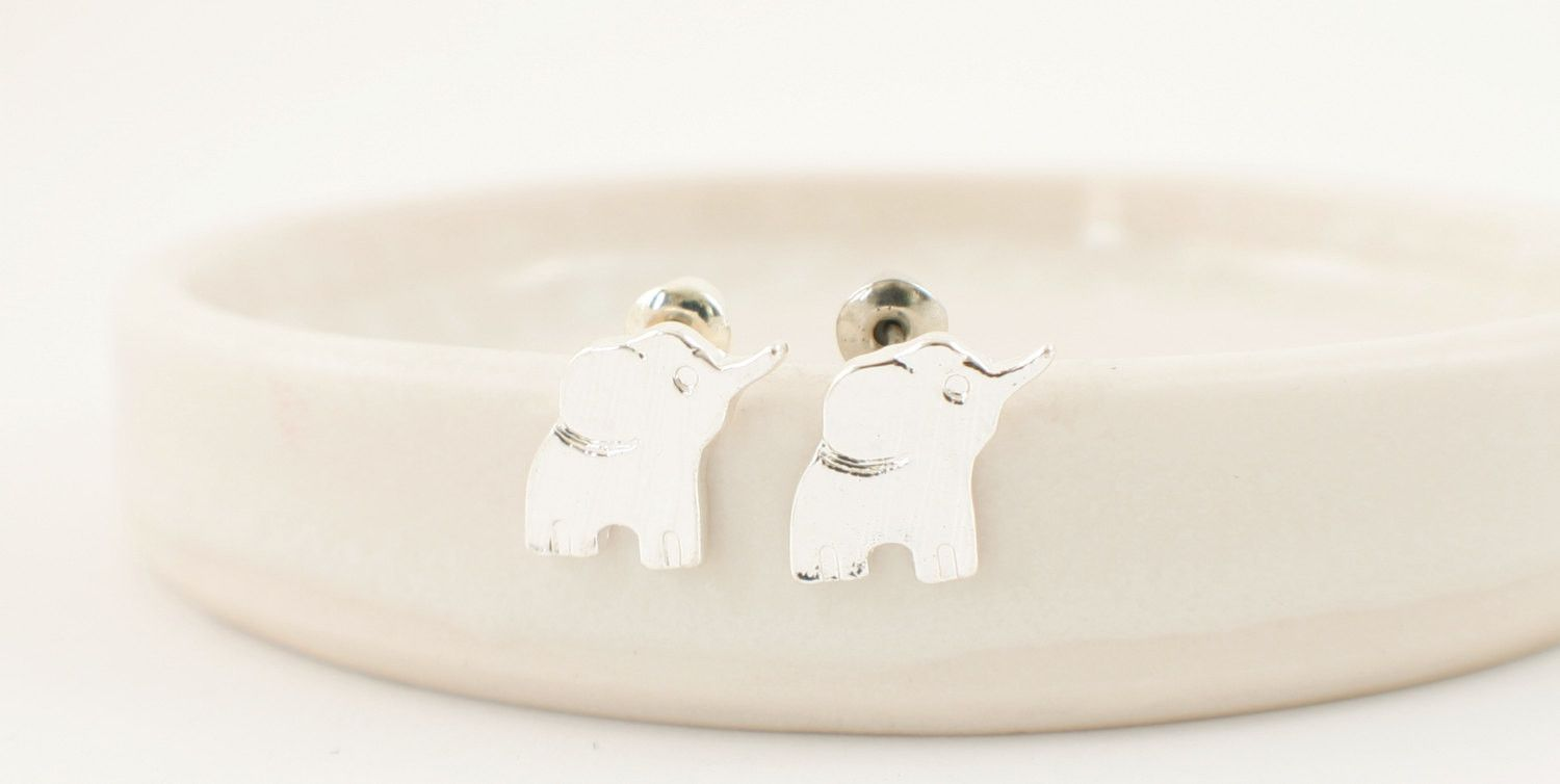 ELEPHANT studs >> cuz you can't wear a real elephant << they get annoyed