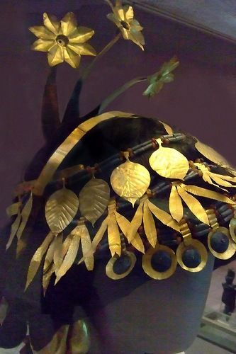 """Jewelry from The Royal Tombs of Ur Detail of a headdress. Not only did Queen Pu-abi's attendants wear this kind of headdress, but so did  many other women in many other tombs. There were so many headdresses that Woolley reported that he was sick of finding them. In the drawing of the """"Great Death Pit"""" there were at least 20 women with similar headdresses. See a high-resolution photograph of the side of the headdress."""