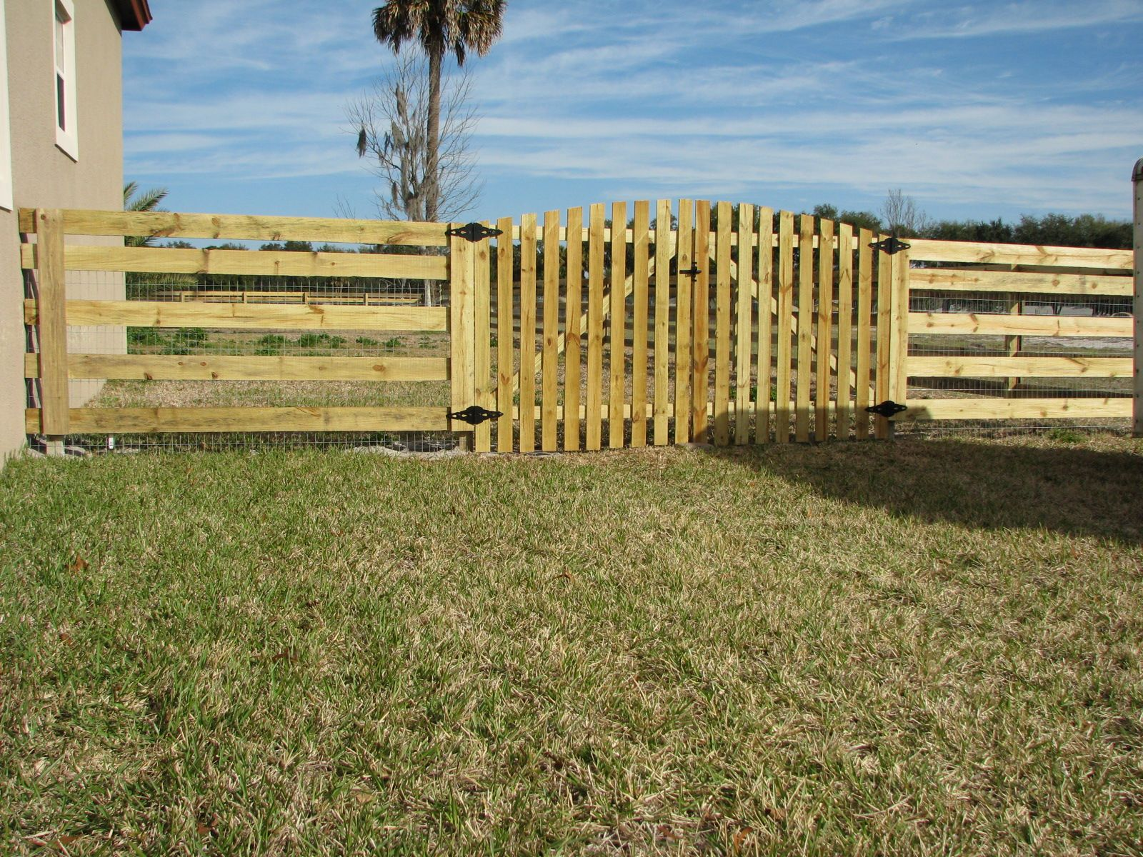 Custom Wood Horse Fence Design With Wire For Added