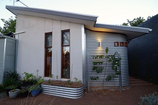 House Extension Clad In Corrugated Iron Also Corrugated Iron Trough As Planter House Elements Steel House Sustainable Architecture