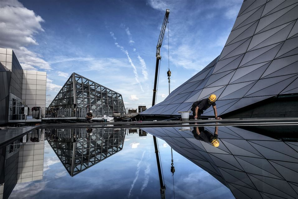 "LYON.- Window cleaners work at the construction of the ""Musee des Confluences"" science centre and anthropology museum in Lyon on October 14, 2014 ahead of its December opening. AFP PHOTO / JEFF PACHOUD.  More Information: http://artdaily.com/[/url] Copyright © artdaily.org"