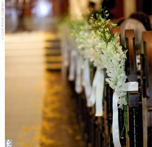 The Knot Your Personal Wedding Planner Pew flowers Pew