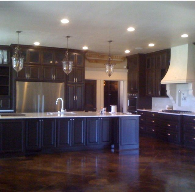 Concrete Floor Dark Cabinets