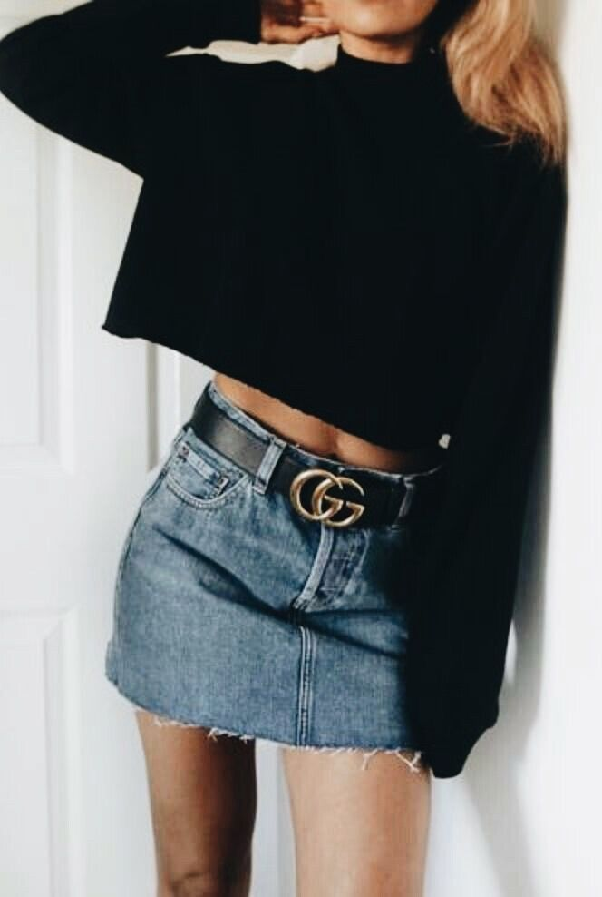 14854f514 Black sweater and belt with blue denim mini skirt. | Fashionista ...