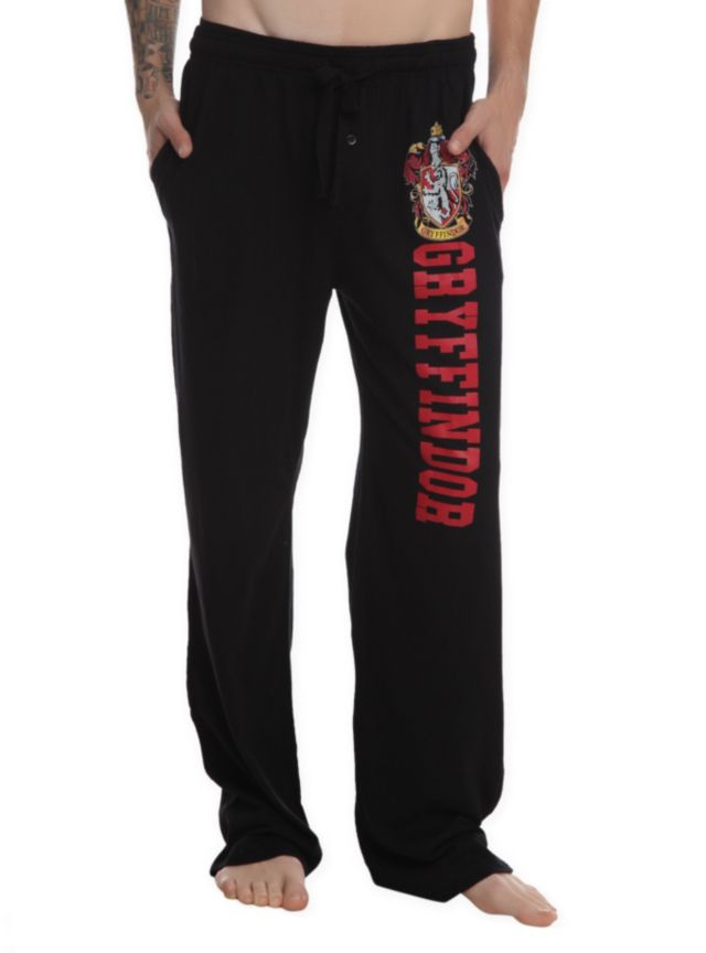 Comfy men's pajama pants with Gryffindor design on the left leg, elastic drawstring waist and single button fly.