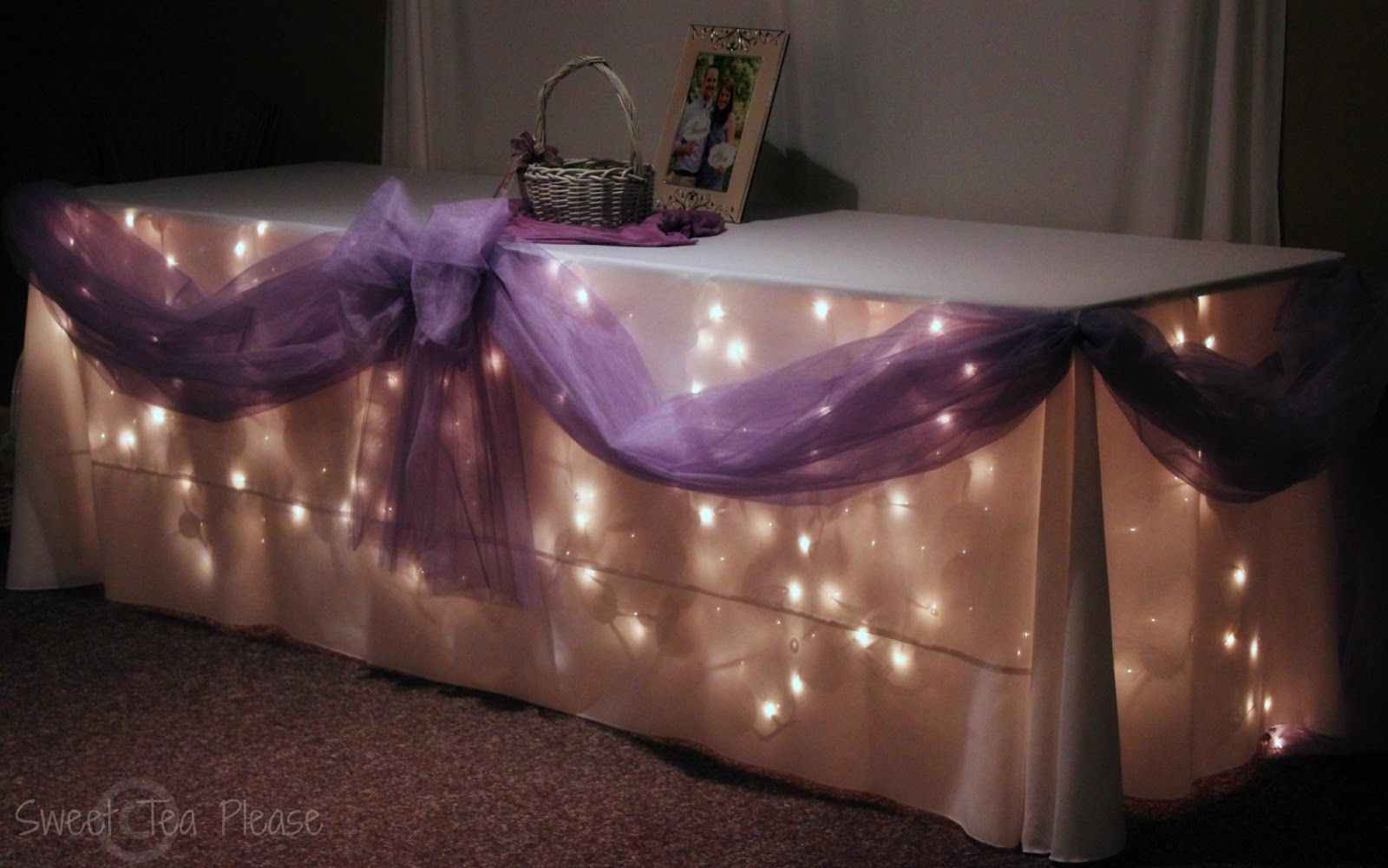 Wedding decorations tulle and lights  Decorating a Cake Table With Lights and Tulle  A Tutorial  mesas