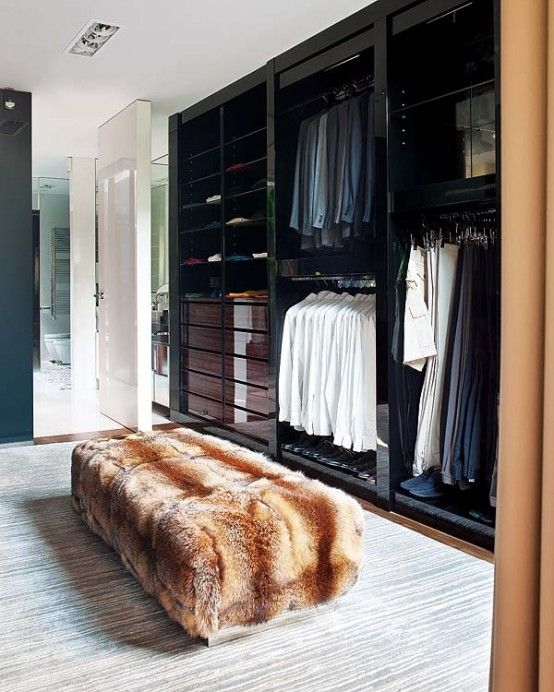 Black lacquer cabinetry with macassar ebony drawer faces make for a luxe man's closet. | More decor lusciousness here: http://mylusciouslife.com/photo-galleries/architecture-and-design-beautiful-buildings-gardens-and-decor/