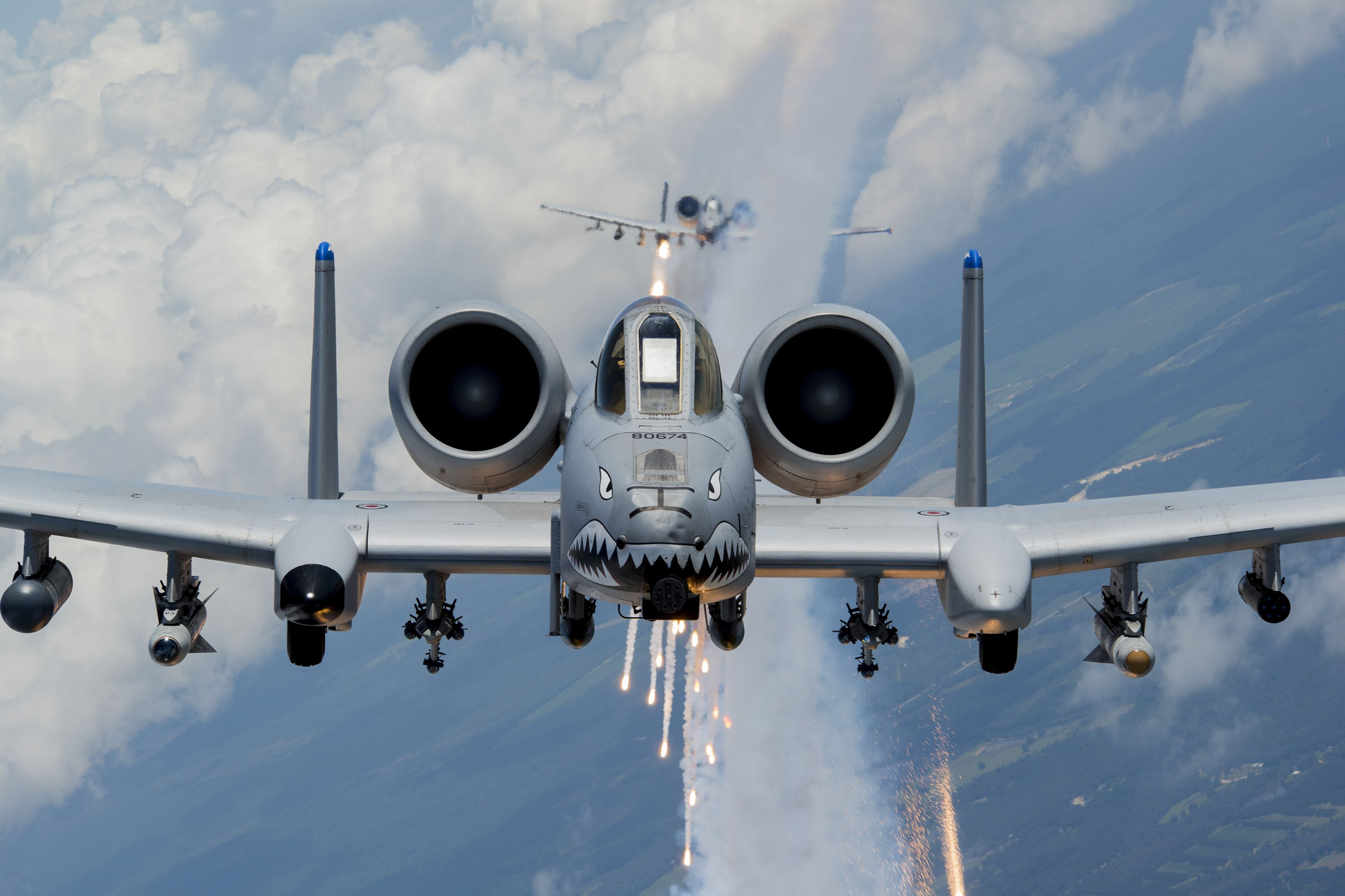 U.S. Air Force Capts. Andrew Glowa, lead, and William Piepenbring, both with the 74th Fighter Squadron out of Moody Air Force Base, Ga., fly two A-10C Thunderbolt II over the skies of southern Georgia, Aug. 18, 2014. Since it was first delivered to Davis-Monthan Air Force Base, Ariz., in October 1975, the A-10 has participated in operations Desert Storm, Southern Watch, Provide Comfort, Desert Fox, Noble Anvil, Deny Flight, Deliberate Guard, Allied Force, Enduring Freedom and Iraqi Freedom.