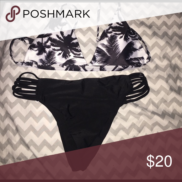 Brand new Palm tree bikini Brand new in package. Both top and bottom size are large. Bottoms fit more like a medium. Top can fit a 36-38 inch bust Swim Bikinis