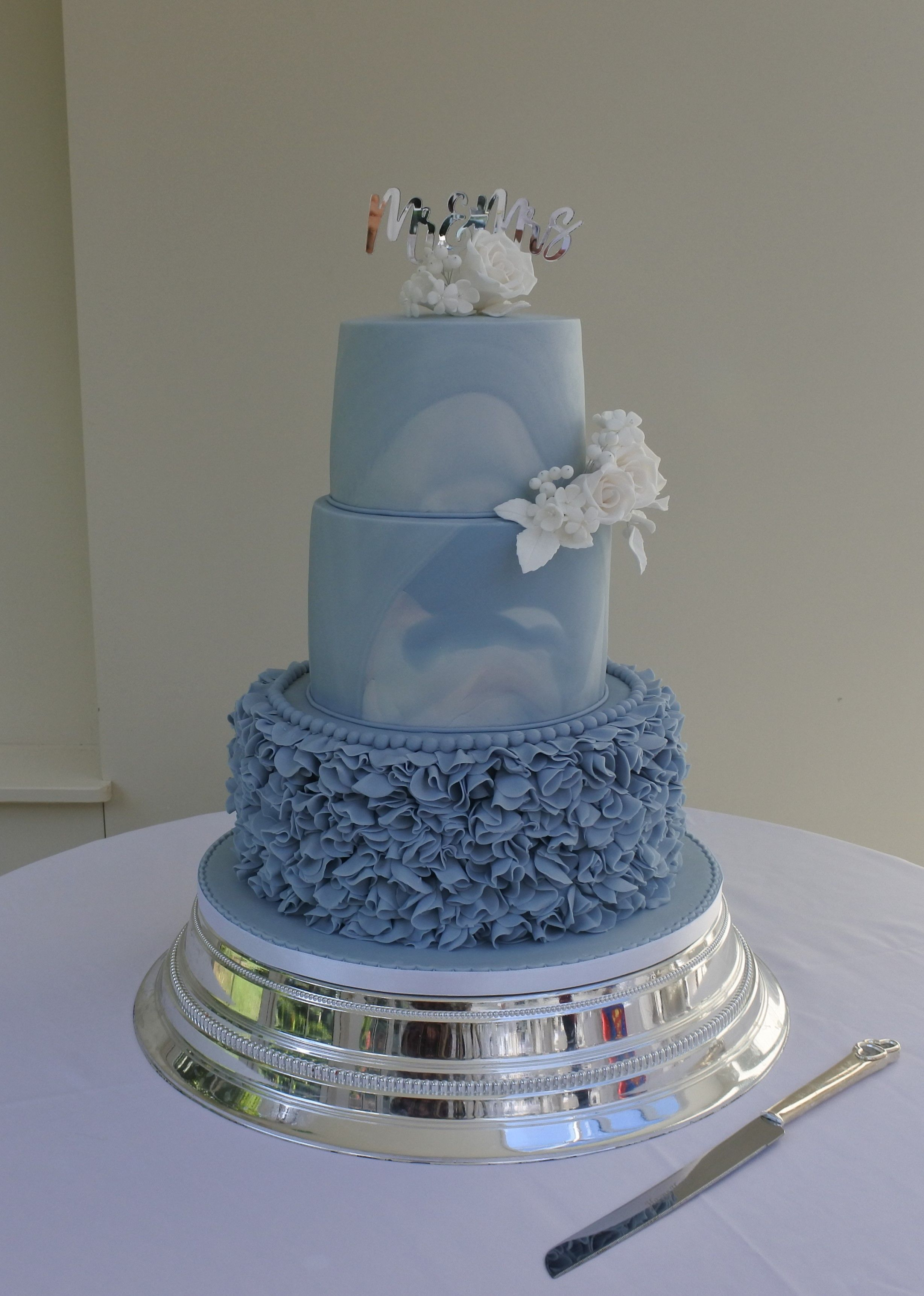 Dusky Blue Ruffles And Marbled Wedding Cake With White Sugar