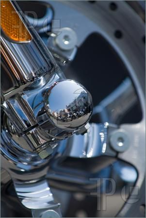 motorcycle abstract picture   Chrome detail of motorcycle with a reflection of other motorcycles ...