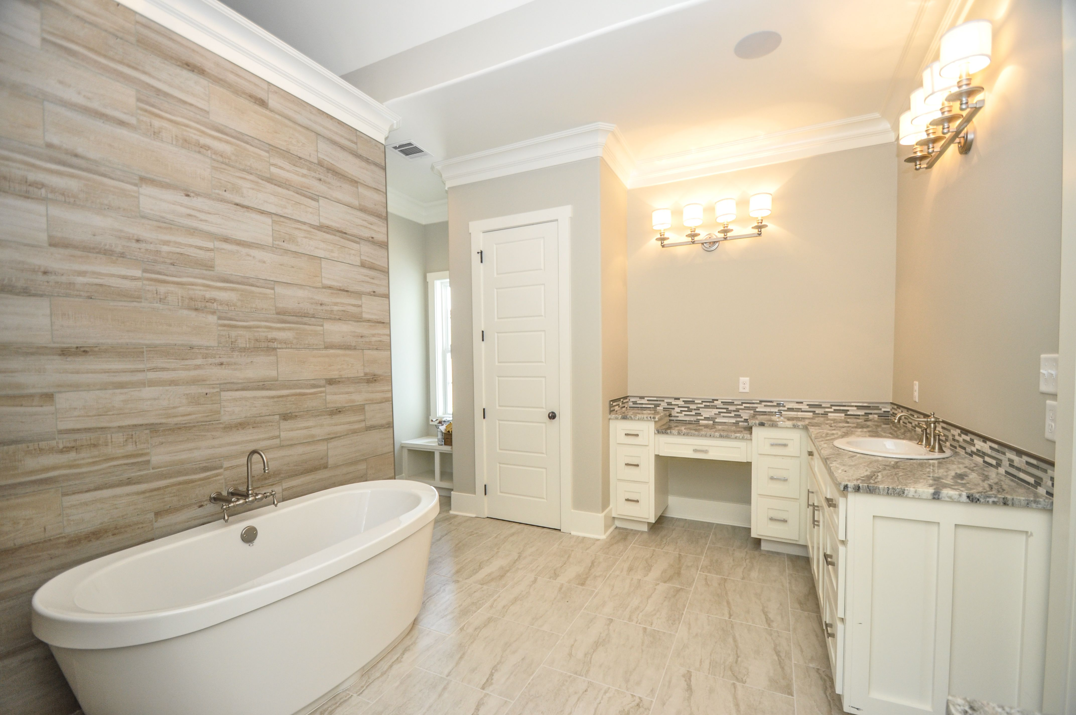 Absolutely stunning master bathroom with wood tile accents, large ...