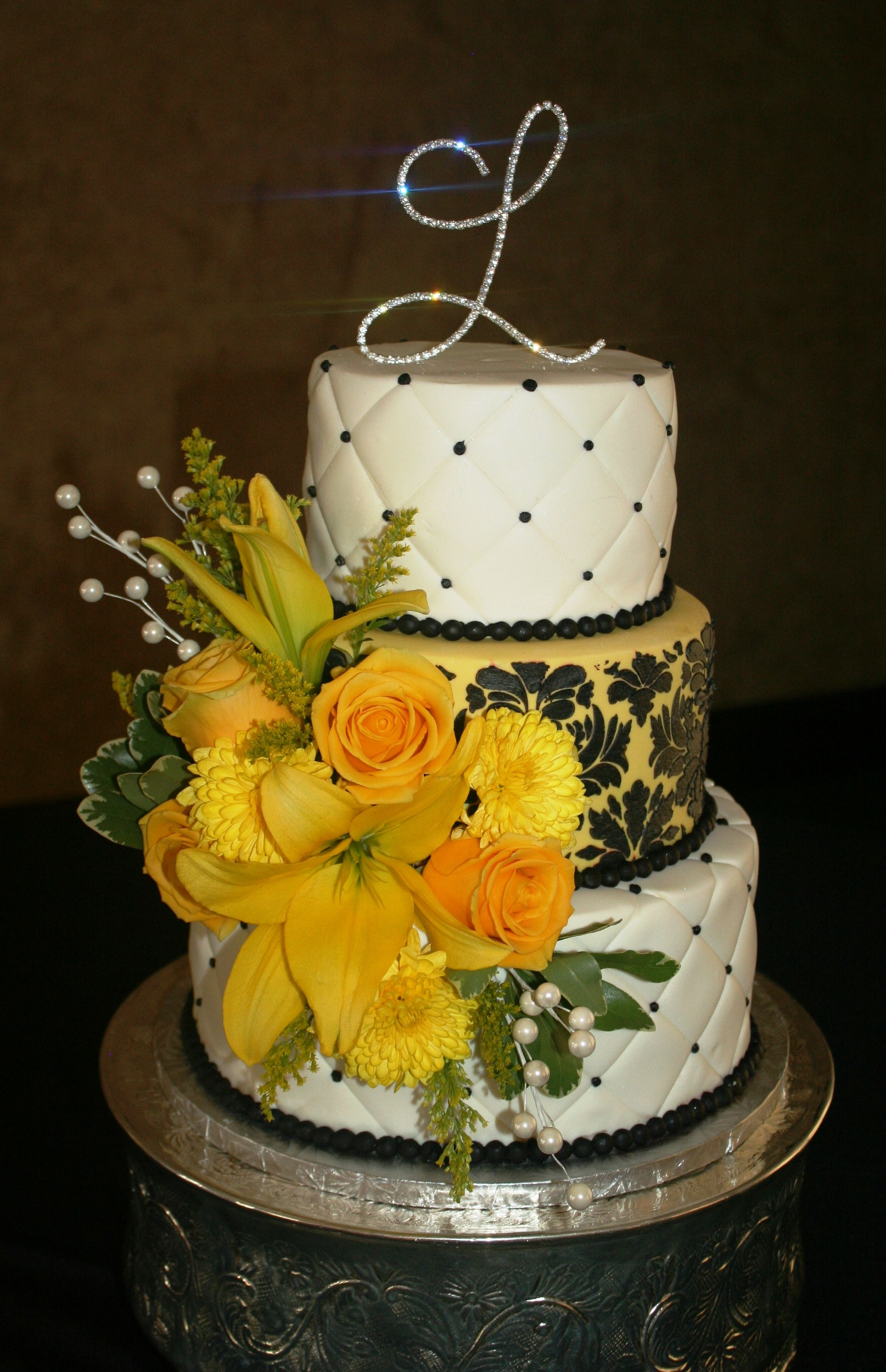 Wedding cakes are no longer simply white. The yellow middle tier of ...