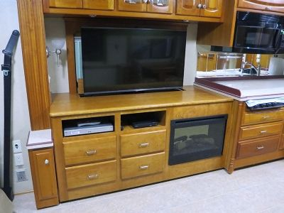 tv fireplace and power lift cabinets