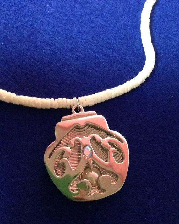 Puka shell necklace with seashell charm on Etsy, $35.00