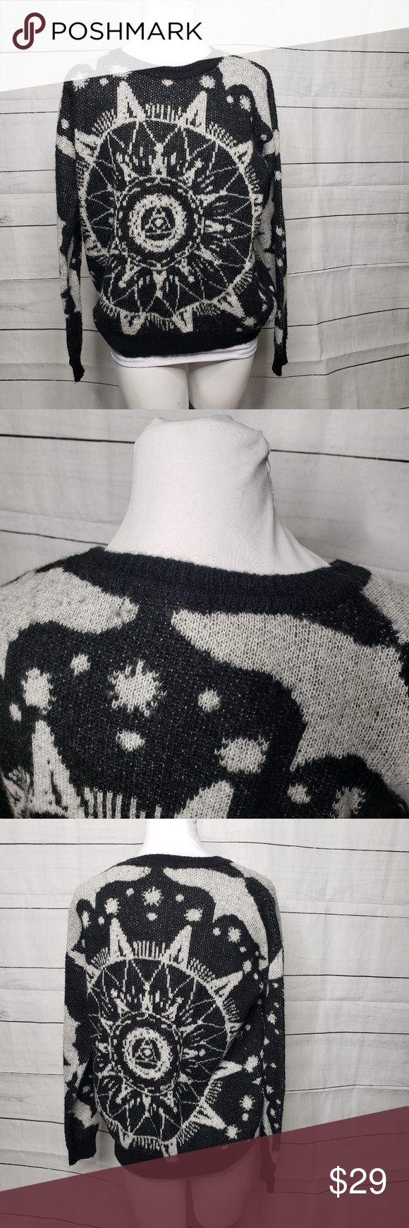 Staring at Stars UO celestial sweater small Staring at Stars from Urban Outfitters celestial design sweater. Black and white. Main image is a compass sun Illuminati looking thing.  66% acrylic 29% nylon 3% wool Overall fuzzy look and cozy feel.  Measurements are taken with a fabric tape measure and are approximate.   Armpit to armpit: 22 armpit to bottom hem: 16.6 shoulder to bottom hem: 24 Staring at Stars Sweaters #fabrictape