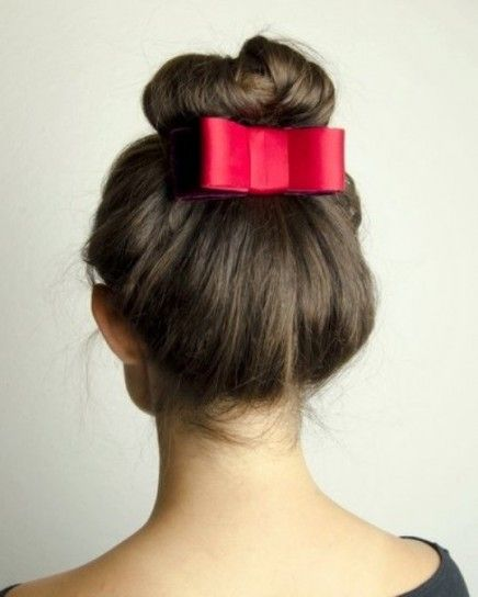Top knot with a red bow